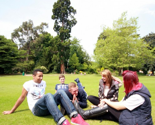 Students relax on the lawn