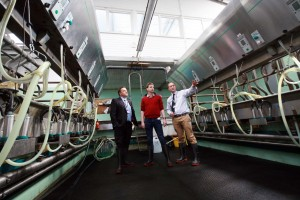 David Russell visits Reaseheath's dairy parlour with Vice Principal Dave Kynaston and head of Agriculture Martyn East