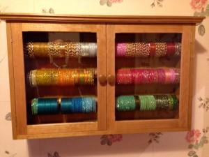 Wall-mounted bangle cabinet in cherry wood, Tony Bramwell