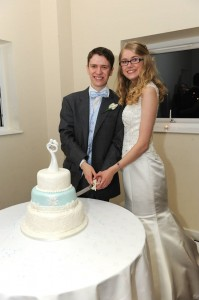 James and Rachel cut their wedding cake - designed by cake decorating expert and alumnus Sam Copeland