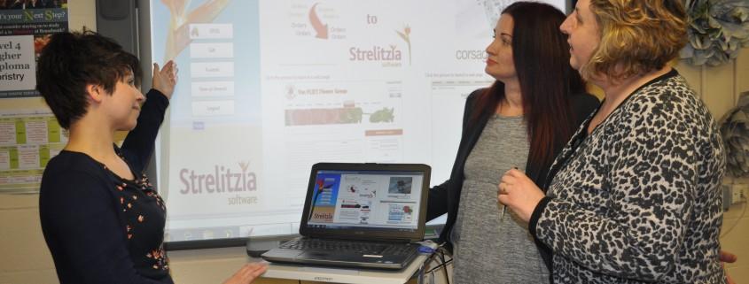 Vicky Venn demonstrates Strelitzia to Sue Poole and Fiona Davies