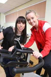 Beth Tweddle and Georgia Lush (Level 3 Sports Student) on exercise bike