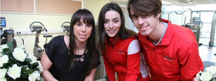 Beth Tweddle cuts ribbon with students Lily Moreland and Jim Kelly