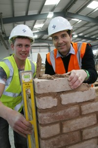 MP Edward Timpson picks up tips from bricklaying apprentice Adam Platt