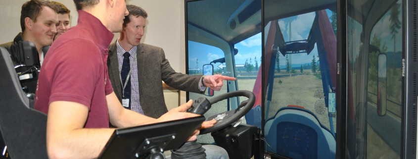 Mike Cullen takes students through simulator test