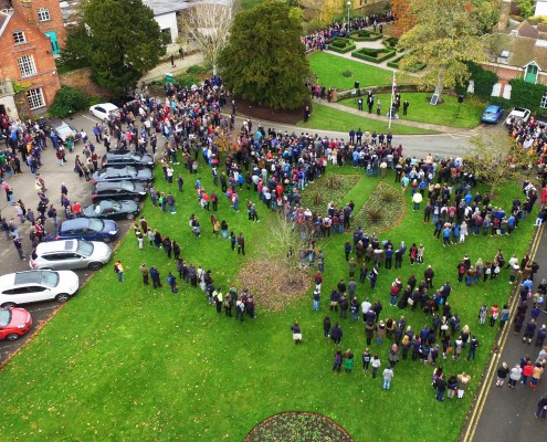 Over a thousand of Reaseheath students and staff gather round the college flagpole to pay their respects at a Remembrance Day service