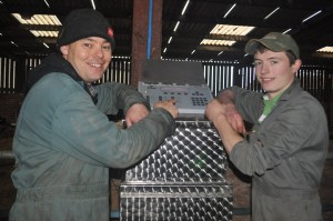 Chris Webb and Larry Anscombe with their automatic calf feeder