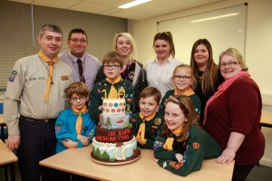 1st South West Cheshire District beaver Henry Duncan (6), and cub scouts George Duncan (9), Brodie Evans (7), Aaliyah Wilson (8) and Hannah Evans (9) receive the cake from Reaseheath head of Food Nick Blakemore, Sam Copeland and students Katie Brittleton, Susan Thomas and Hayley Clibborn
